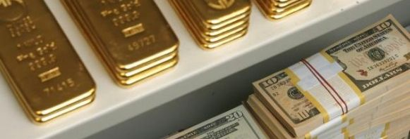 c_740_198_16777215_00_images_assets_GOLD_currency-wars-gold-bars-and-us-dollar-bills-are-pictured-in-a-safe-in-a-bank-in-vien-581x416.jpg